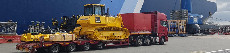 Komatsu Bulldozer On Transport Ready For Shipment