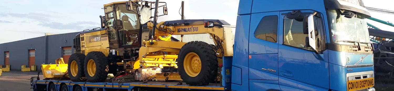 Komatsu Motor Grader On Transport Jpg